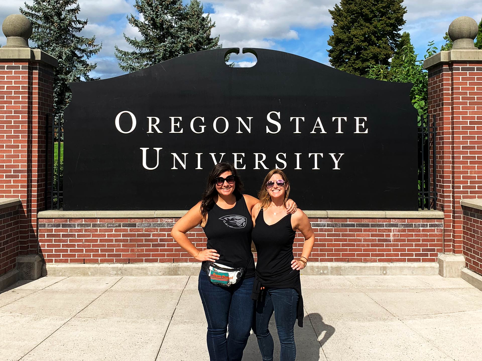 Heather Wofford and Amanda Price standing in front of the OSU football sign.